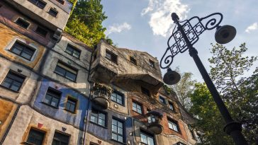 bottom view on exterior of famous colorful hundertwasser house in vienna, austria.