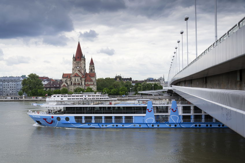 cruise ship on danube with st. francis of assisi church on mexikoplatz