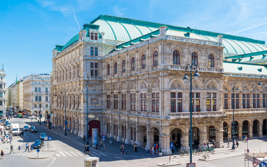 state opera house on albertina square with people and traffic in downtown vienna, austria
