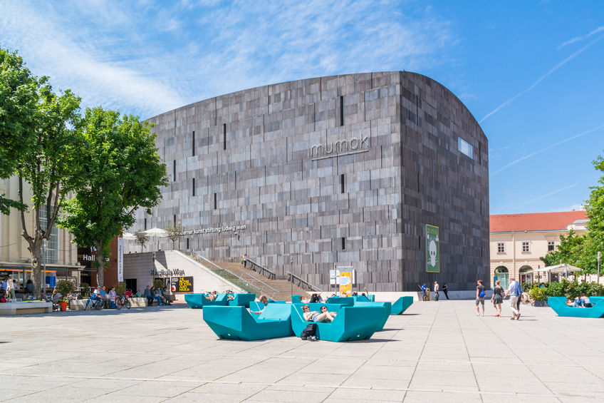 museums quartier square with people and modern art museum mumok in vienna, austria