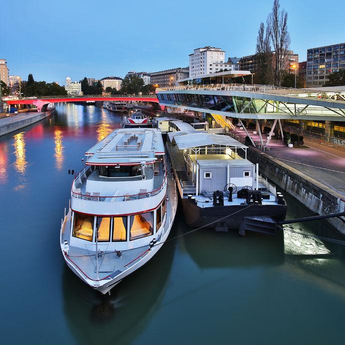 vienna at night, danube canal, pier near schwedenplatz in central vienna