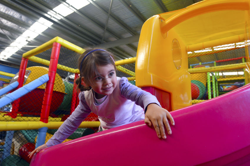 little girl play in indoor playground