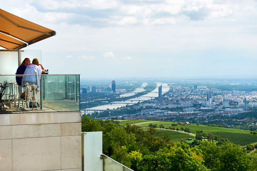 restaurant on a top of a building and aerial view of vienna city