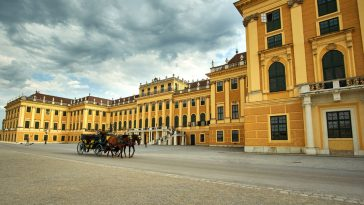 palace schönbrunn with carriage and horses