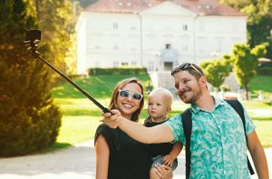 young beautiful family with cute toddler child making selfie photo.