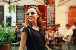 beautiful woman, smiling tourist on the background of european old town street