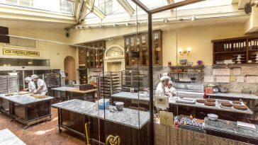 production of traditional viennese cake sacher in cafe-patisserie zacher cafe on the main street of vienna
