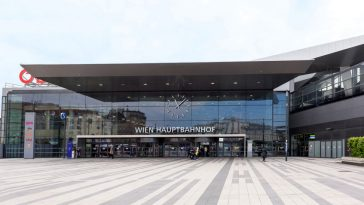 facade of the main railway station of wien with obb logo company and people