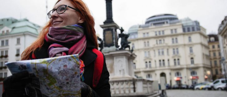 young red hair woman using city map