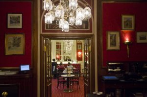 interior of the famous sacher hotel bar, with people around