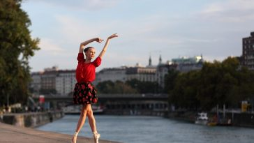Beautiful ballerina dancing on the street in front of vienna