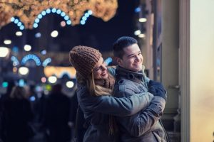 Young lovers enjoy on the street at night in the city